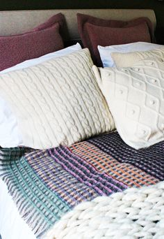 Here's a glimpse of the bed in the master bedroom. The bed is by Vispring and consist of a deep comfort wool filled mattress and mattress topper. The duvet was also filled with wool and is from the Wool Room. Adorning the bed, were beautifully hand-knitted throws by Melanie Porter and Exmoor Horn Wool cushions. Inside, Quite Literally, the Coziest Home in London - Darling Magazine