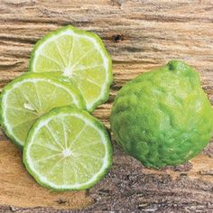 The Kieffer or Thai Lime is a dwarf citrus tree suitable for indoor growing that bears edible, bumpy limes; both the fruit and the foliage is highly fragrant. Citrus Trees, Fruit Trees, Trees To Plant, Kumquat Tree, Green Fruit, Nutrition Education, Vegetarian Recipes, Food And Drink, Cooking