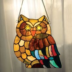 Whooo's that, glowing in a sunlit window? Add a bit of beauty to your windows with this handcrafted, Tiffany-style stained glass window panel crafted from 69 cuts of art glass and 2 cabochons. These a