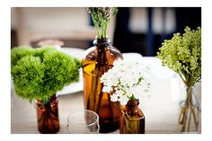 I love the apothecary jars with simple monochrome bunches.  A deconstructed arrangement?