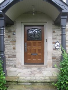 This Amberwood door looks gorgeous with the stone work on this home! Also the intricate wrought iron work is magnificent!
