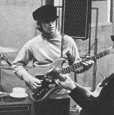 George Harrison (playing Bass)