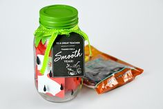 DIY Strawberry Gift Card Jar: Step 6. Close the mason jar with its lid, finishing off with a green ribbon and the free, printable Thank You tag for your teacher.
