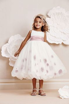 Alfred Angelo Girls Dress Style 6670- Sleevless Satin and Net Dress with Organza Flowers  This amazing dress is like no other. The beauty is found in all the beautiful details on the dress. The sleeveless satin style features three dimensional flowers in the net skirt that would be perfect for a flower girl dress.  http://www.flowergirldressforless.com/mm5/merchant.mvc?Screen=PROD&Product_Code=AA_6670&Store_Code=Flower-Girl&Category_Code=Yellow
