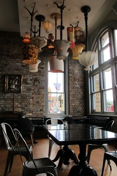 collection of vintage floor lamps light shades + creative thinking = upcycled lighting installation (Northern Steamship cafe in Auckland, New Zealand)