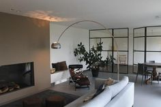 Modern living in an old farm by Villaidea with Flos Arco