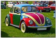 Multi colored VW Beetle @Taryn Spivey... Green, Red, blue, Yellow, purple! Slug Bug... No TAG BACKS!!!!