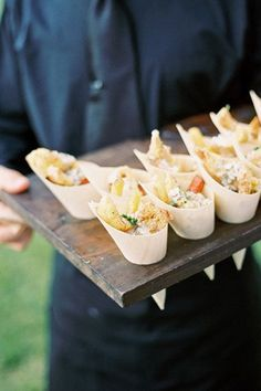 Fun idea: Serve your cocktail hour appetizers in paper cones! Easier to hold while mingling than small plates