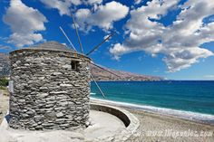 A windmill on the shore of Korthi in Andros