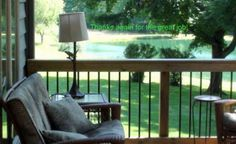 A beautiful deck with wooden rails and aluminum pickets in a gorgeous setting.