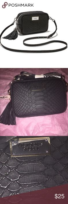 NWT Victoria's Secret Black Python Crossbody 🖤 NWT Victoria's Secret black python cross body bag. Limited Edition. These are no longer for sale. This is bag is so adorable and still in the packaging. A must have 🖤🖤 it has a super cute hassle a pouch in the bag as well. It is in perfect shape. Victoria's Secret Bags Crossbody Bags