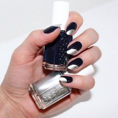 Recreate this gorgeous nail art look inspired from the runway using an essie black blue nail lacquer and accent each nail with a silver metallic for a memorable manicure.
