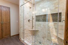 Traditional Neutral Master Bath | construction2style | Shower Floor |The Tile Shop, Broken Brushed Volcano Cobble 14×14| $11.99 sq ft.Shower Wall Surround |The Tile Shop, Queen Beige Polished 3×6| $13.99 sq ft.Niche |The Tile Shop, Australia Caberra Stria Mosaic Tile 12×12| $39.99 sq ft.Bathroom Floor |The Tile Shop, Nordic Brown| $4.99 sq ft.Vanity |Custom built by construction2styleDecor |Anna Bailey