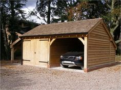 Our garage & log store with one enclosed bay, partition wall & softwood double garage doors. Timber Garage, Carport Garage, Garage Doors, Wooden Garages, Oak Framed Buildings, Timber Buildings, Garden Buildings, Bungalow Exterior, Exterior House Colors
