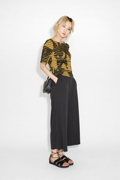 In a bubbly, crimped material, this cotton-stretch top is totally tee-rrific! Slightly cropped with longer tee arms and scooped out neckline.
