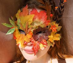 Red Orange Mabon Autumn Mask by magpiesmasquerie on Etsy, $29.00 An idea for crafts with the kids. Dollar store leaves, some hot glue and yarn <3