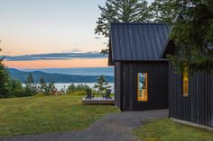 Overlooking the Hood Canal, the Coyle Cabins are a Washington retreat with Danish roots. Clean lines and simple forms dominate the three gabled structures that make up the residence. The dark cedar exterior cladding is contrasted on the interior by. Seattle Architecture, Modern Architecture, Sustainable Architecture, Tiny House, Timber Cabin, Exterior Cladding, Built Environment, House And Home Magazine, Architect Design