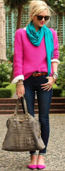 I like the layering of the white button-down with the sweater tucked in in the front.