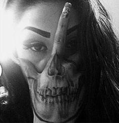 Tattooed hand skull face