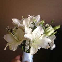 Assorted white flowers hand-tied with ribbon the bride's grandmother made.