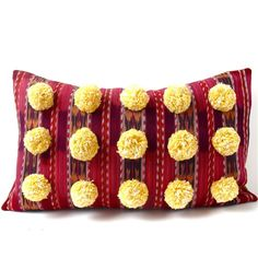 """This large expressive pillow is handmade from indigenous guatemalan cotton fabric, recycled burlap and wonderful yellow pom poms. - Dimensions: 29"""" x 17"""" - Down/feather insert included - Burlap back w"""