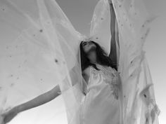 Bespoke customised Brides Veil with embroidered tulle flowers by Hatmaker Jonathan Howard
