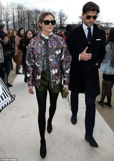 Chic couple: Olivia Palermo enlisted the services of her rather dapper fiancé Johannes Huebl as she attended the Valentino Paris Fashion Wee...
