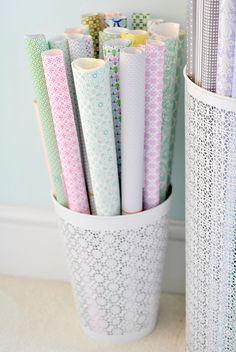 Gift wrap holder --use a small trash can to hold rolls of gift wrap.