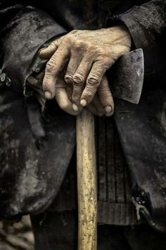 Free Write Friday #39: Image Prompt - Old Man With Axe | Tell his story…Grandpa was a hardworking man. He toiled the earth, tilling, planting and sowing crops to be gathered and preserved by his loving wife of over 60 years. They met as mere children. Grew up together, married, and reared half a dozen kids while raising ten times or more as many chickens. Home was a cabin hewed by logs cut from his own timberland. Firewood was chopped every evening before sunset.