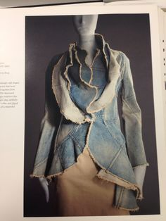 Denim is cut into seemingly odd shapes here, as though the jacket had been haphazardly patched together from recycled blue jeans. The distressed denim and frayed edges reinforce this idea. Undulating shapes that skillfully form a layered shawl collar and flared hem reveal the hand of a masterful designer. Spilker.K., and Takeda S.,ed., 2007. Breaking the Mode.1st ed. Italy(Milan): Skira Editore S.p.A. p67 (picture in pinterest )