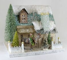 Beautiful cardboard house with sparkles and glitter and a festive moose. #GlitterSparkle