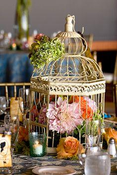 birdcage centerpiece with pink dahlias