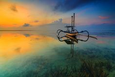 A Boat of Karang Beach | 500px Prime