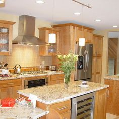 medium to lighter wood stain with light counter tops....