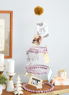 DIY tomato cage holiday card display by Emily Henderson for Redbook