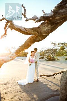 Bride and Groom on Driftwood Beach Jekyll Island Georgia.