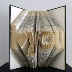 I Love You - Anniversary Gift - Boyfriend / Girlfriend Gift - Paper Anniversary Gift - Book Sculpture - Handmade - Husband / Wife. $95.00, via Etsy.