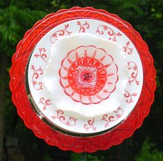 Hand painted platter, red and white soup bowl and a hand painted dessert dish make up this forever flower.