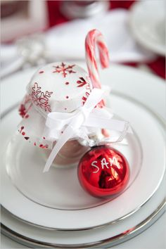 Easy holiday decor idea! Use an ornament for a place card! #holidaytable