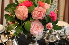 {January-March} CAMELLIA: centerpiece in silver containers