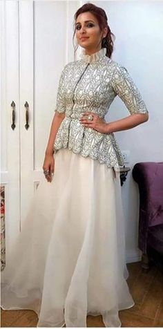 Parineeti style Peplum Top With Organza Skirt Source by dussaanu # Casual Outfits indian bridal lehenga Party Wear Indian Dresses, Designer Party Wear Dresses, Indian Gowns Dresses, Indian Bridal Outfits, Kurti Designs Party Wear, Indian Fashion Dresses, Dress Indian Style, Indian Designer Outfits, Lehenga Designs