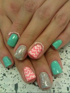 Turquoise, silver glitter, and salmon pink bases with white chevron detail on ring finger