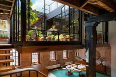 You wouldn't mind living in a stable, boathouse, boiler room, post office or even a wartime bunker once they undergo modern renovations like these, contrasting the original historic architectural elements with smooth new wood surfaces and lots of glass. A former caviar warehouse in New York City gets a lantern-like sunken courtyard, a bridge connects two old brick food factory buildings, a Victorian church goes contemporary and priests party it up in a seminary turned retirement home.