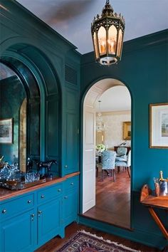 Rich peacock blue butler's pantry by Meg Braff.