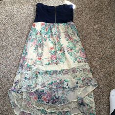 Floral dress with zip up shirt Floral bottom with lace ends it's a high low dress and the top part has a zipper and elastic is good. Great casual or party dress love fire Dresses