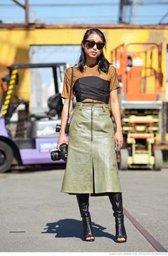 Margaret Zheng | her leather military skirt, tall open toe boots...