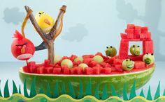 "Carve your favorite Angry Bird characters their very own yacht that doubles as a serving vessel for fruit salad.  This sculpture is guaranteed  to bring a smile to guests' faces.   <a href=""http://watermelon.org/Carvings/Angry-Birds-67.aspx"" target=""_blank""> Learn how to make it here</a>"