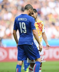 Leonardo Bonucci of Italy and Nolito of Spain argue during the UEFA EURO 2016 round of 16 match between Italy and Spain at Stade de France on June 27, 2016 in Paris, France.