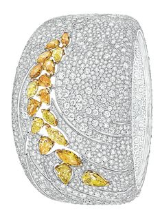 Impression de Blé #Bracelet from #LesBlesDeChanel - #Chanel - #FineJewelry collection in 8K white and yellow gold set with 3 #FancyCut intense/vivid #YellowDiamonds (2.7 cts), 2639 #BrilliantCut - #Diamonds (37.9 cts), 2 #MarquiseCut fancy intense/vivid yellow diamonds (1.1 ct) and 12 fancy cut multicoloured diamonds (4.5 cts) - July 2016