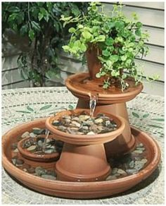 Cute idea! DIY Terra Cotta Clay Pot Fountain